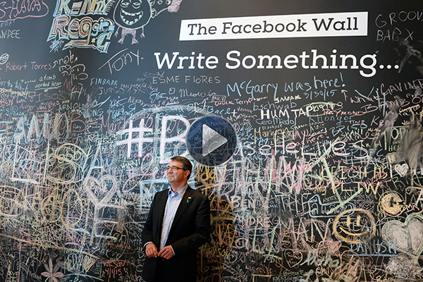 Defense Secretary Dr. Ash Carter in front of Facebook wall during recent trip to Silicon Valley.