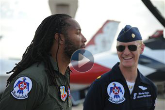 Photo: Larry Fitzgerald, Arizona Cardinals wide receiver, talks to Maj. Michael Fisher, U.S. Air Force Thunderbirds advance pilot/narrator, before taking a flight in a Thunderbird jet March 14. Fisher served as an F-16 instructor pilot and flight commander for the 310th Fighter Squadron at Luke Air Force Base. (U.S. Air Force photo by Airman 1st Class Pedro Mota)